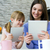 mother and daughter using a digital tablet in kitchen stock photo © nenetus