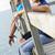 człowiek · wskazując · coś · posiedzenia · sympatia · plaży - zdjęcia stock © nenetus