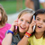 group of childrens using mobile phones in the park stock photo © nenetus
