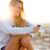 mooi · meisje · vergadering · dak · luisteren · naar · muziek · outdoor · portret - stockfoto © nenetus
