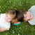happy young brothers lying on grass stock photo © nenetus