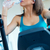 young woman with elliptic machine drinking water in the gym stock photo © nenetus