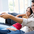 happy couple sitting on sofa and watching television together stock photo © nenetus