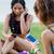 running girls having fun in the park with mobile phone stock photo © nenetus