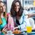 drie · jonge · vrouwen · koffiepauze · voorjaar · glimlach · koffie - stockfoto © nenetus