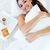 beautiful young woman having breakfast on bed stock photo © nenetus