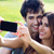 happy young couple with smartphone at the park stock photo © nenetus