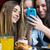 amigos · smartphones · grupo · menina · sorrir - foto stock © nenetus