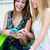 two friends having fun with smartphones stock photo © nenetus