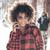 girl with afro hairstyle using smart phone stock photo © neonshot