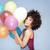 happy young girl with afro holding balloons stock photo © neonshot