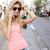 sonriendo · nina · gafas · de · sol · caminando · calle · compras - foto stock © neonshot