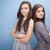 feliz · jovem · irmãs · posando - foto stock © neonshot