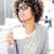 elegant african american woman drinking coffee working stock photo © neonshot