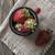 vintage enamel mug filled with fresh strawberries stock photo © nessokv