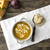 bowl of hot pumpkin soup with cream on wooden table stock photo © nessokv
