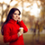 autumn woman holding coffee cup outside in nature stock photo © nicoletaionescu