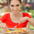 happy young woman eating pizza stock photo © nicoletaionescu