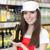 pracownik · olej · asian · uniform · kask · młodych · stałego - zdjęcia stock © nicoletaionescu