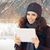 Winter Woman with Tablet Outside in the Snow stock photo © NicoletaIonescu