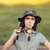 circumspect explorer girl with camouflage hat and binoculars stock photo © nicoletaionescu