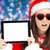 surprised christmas girl with heart sunglasses and tablet stock photo © nicoletaionescu