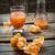 fresh juice of tropical citrus fruits on wooden background stock photo © nikolaydonetsk