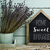 text home sweet home in a house shaped signboard stock photo © nito