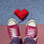man in sneakers and heart shaped coil of yarn on the asphalt stock photo © nito