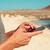 hombre · celular · teléfono · playa · verano · sonriendo - foto stock © nito