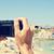 man taking a picture at cala conta beach in san antonio ibiza i stock photo © nito