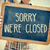 young man with a chalkboard with the text sorry we are closed f stock photo © nito