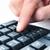 man using the numeric keypad of a computer keyboard stock photo © nito