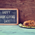 roast turkey and chalkboard with the text happy thanksgiving day stock photo © nito
