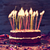 birthday cake with some lit candles filtered stock photo © nito