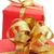 dourado · papel · de · embrulho · arco · apresentar · decoração · natal - foto stock © nito