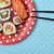 sushi in a red plate patterned with white dots stock photo © nito