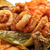 spanish combo platter with fries grilled pepper and fried shrim stock photo © nito
