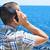 młody · człowiek · słuchanie · muzyki · słuchawki · portret · uśmiech · twarz - zdjęcia stock © nito