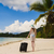 girl with a suitcase on the beach stock photo © o_lypa