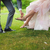 groom helping bride to put on shoe stock photo © o_lypa