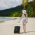 woman with a suitcase on a tropical beach stock photo © o_lypa
