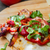 slice of pizza with peppers, bacon and herbs on a wooden board stock photo © oei1