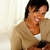 glimlachende · vrouw · naar · bericht · portret · mobieltje - stockfoto © pablocalvog
