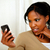 pensive black woman using her cellphone stock photo © pablocalvog