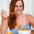 Relaxed pretty young woman eating breakfast stock photo © pablocalvog