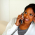 Afro-american girl looking to her right on phone stock photo © pablocalvog