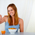 Beautiful young woman eating breakfast stock photo © pablocalvog