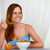 Beautiful blonde young woman eating breakfast stock photo © pablocalvog