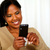 Attractive black woman sending a text message stock photo © pablocalvog
